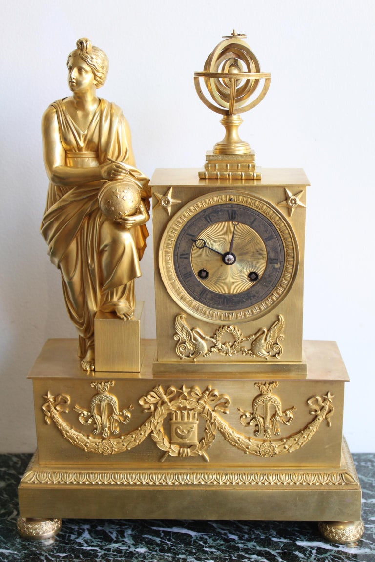 Napoleon 3 gilt bronze clock representing an allegory of Astronomy. Good condition. Dimensions: Height 38cm, width 26cm, depth 10cm