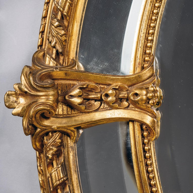French Napoleon III Carved Giltwood Oval Marginal Frame Mirror For Sale