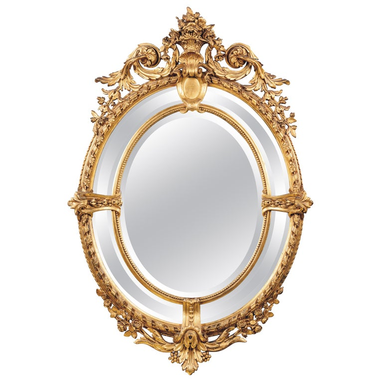 Napoleon III Carved Giltwood Oval Marginal Frame Mirror For Sale