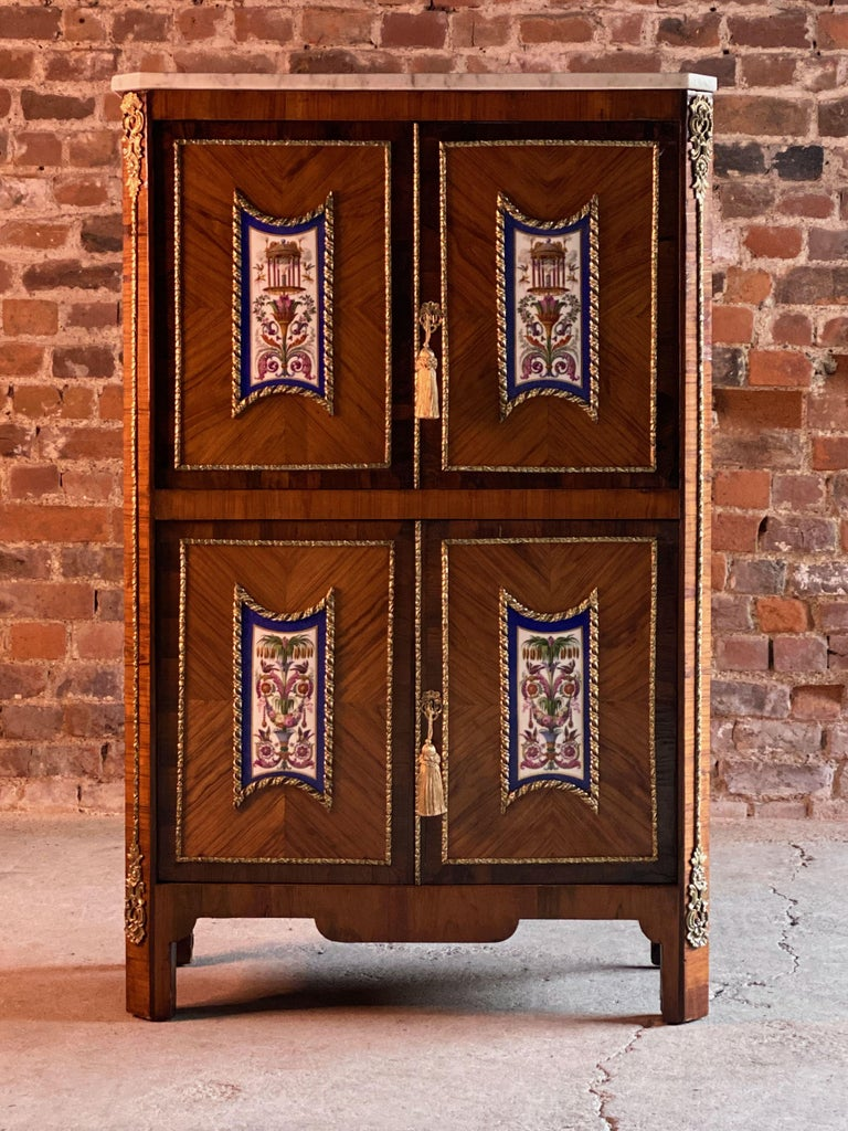 Napoleon III French Escritoire cabinet Kingwood and rosewood France 1890  We are delighted to offer a 19th century French quarter veneered kingwood and rosewood cross banded Escritoire Cabinet circa 1890, with gilt metal mounts, the white