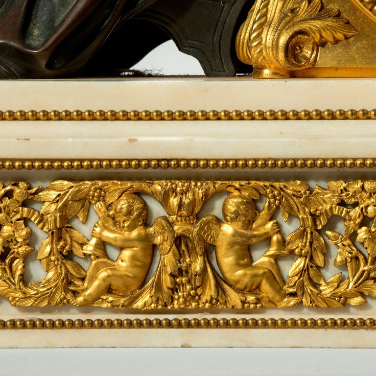 A good Napoleon III gilt mantel clock by Deniere, the dial supporting a reclining bronze classical muse reading a large tome, on a white marble plinth decorated with classical ormolu mounts of acanthus scrolls enclosing putti. Signed Deniere Ft. de
