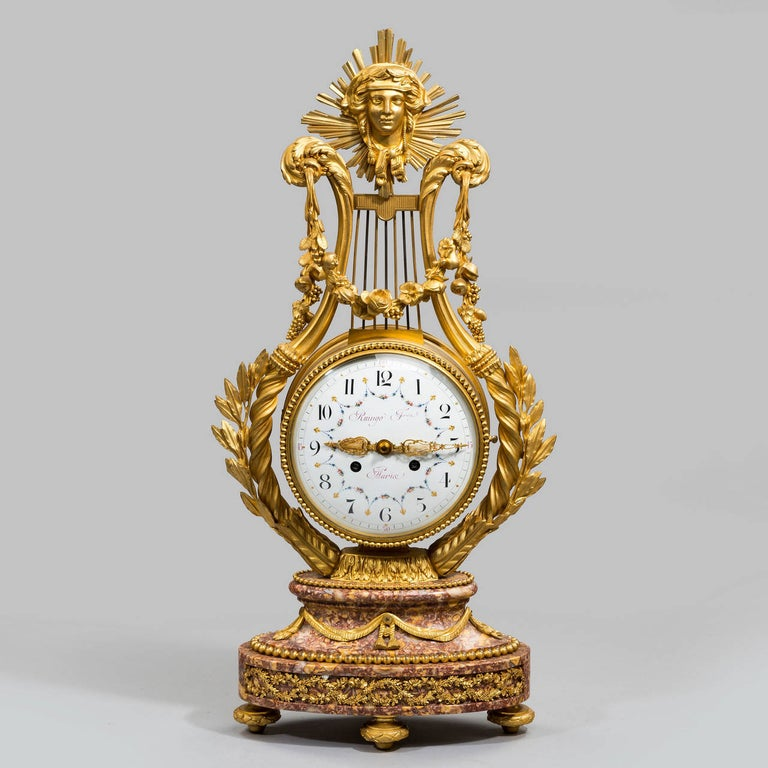 A superb Napoleon III Lyre clock by 'Raingo Press, Paris' with an exquistely painted enamel face and finely cast ormolu hands in the shape of lyre. The movement stamped 'P.George, Paris'.