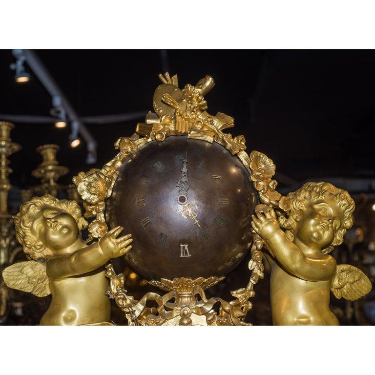 Gilt Napoleon III Ormolu and Patinated Bronze Figural Mantel Clock For Sale