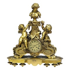 Napoleon III Ormolu Mantel Clock with a Bust of a Maiden on a Pedestal