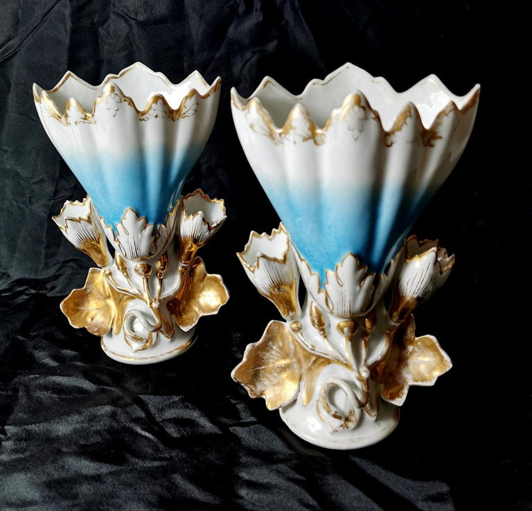Romantic bridal vases have the classic funnel shape, flower and leaf decorations, soft-shaded colors, and gilding. They were called wedding vases (vase d'Eglise marièe) because they were given as gifts by the married couple to the church where the