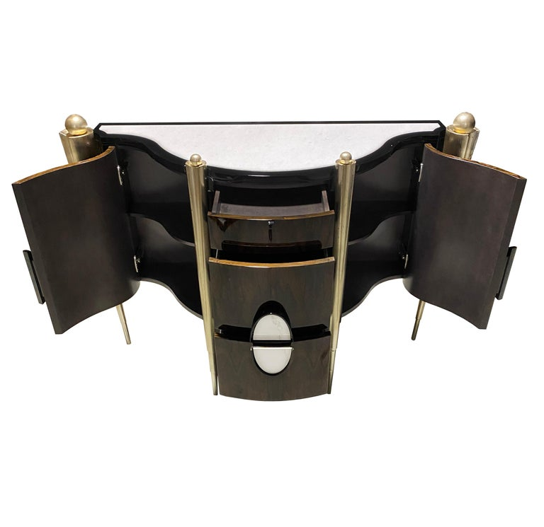 Subtly elegant, this 'Napoleon' console table, with its marble top and brown lacquered veneer base makes a timeless addition to any home. There's no doubt that this luxurious, hand finished piece will create an instant feature in any room of the