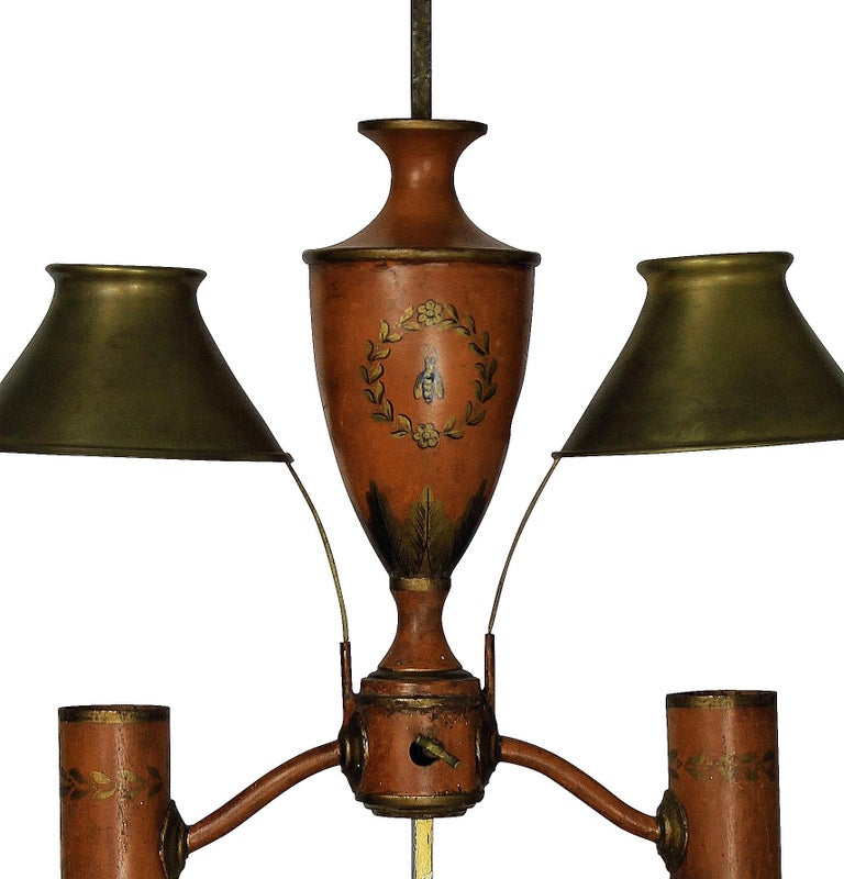 A French Napoleon III hand painted tole desk lamp in orange and gold leaf, with adjustable brass shades. In the Napoleonic revival style, depicting bees.