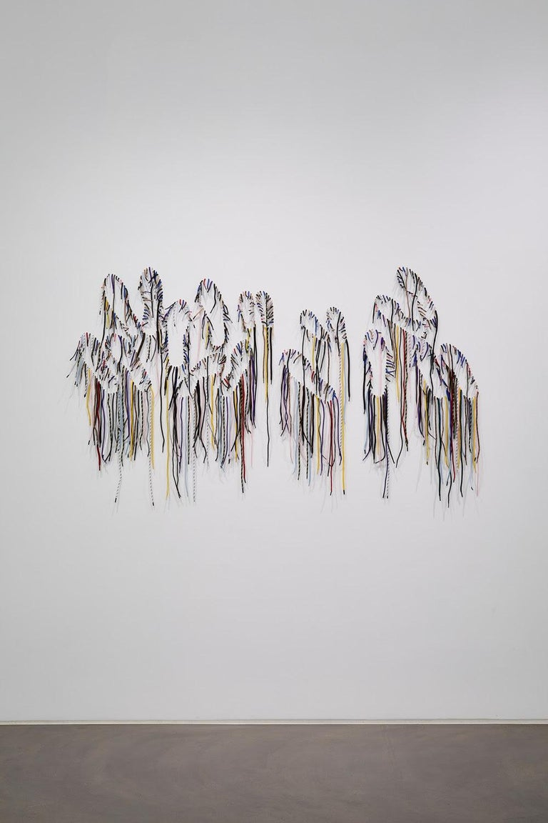 'Sole Revel' (2020) is the latest work from Nari Ward's signature shoelace series where he renders words and phrases out of shoelaces inserted into a wall. For the artist, who ascribes a certain amount of animism to his materials, the shoelaces make