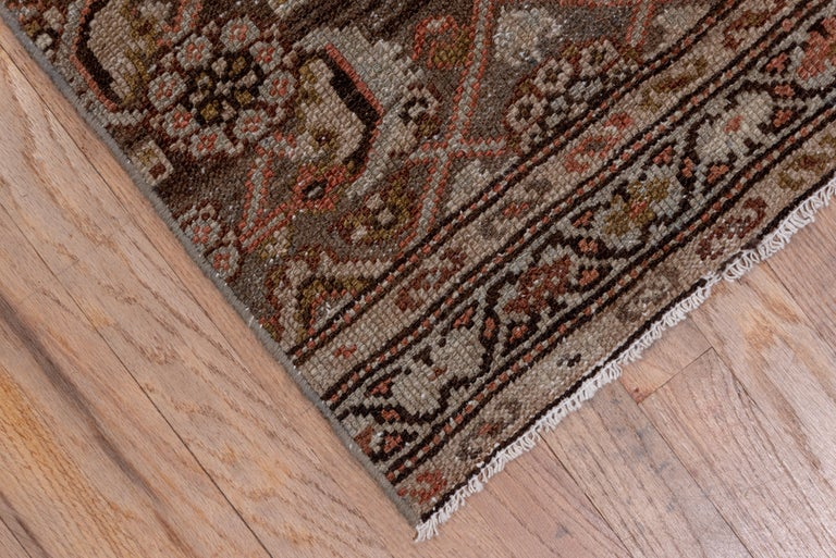 The brown field has a jogged Herati design with dark brown details. Cut from a wider piece.