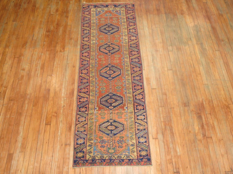 Mid-20th Century Narrow Antique Persian Heriz Runner For Sale