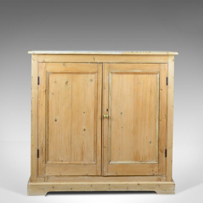 This is a narrow antique pine cupboard, an English, Victorian kitchen  cabinet dating to - Narrow Antique Pine Cupboard, English, Victorian, Kitchen Cabinet