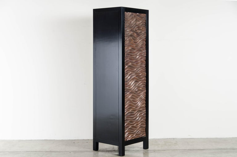 Narrow Cabinet with Gobi Design Single Door with 4 shelves  Antique Copper Hand Repousse Elmwood Lacquered Limited Edition  Repousse´ is the traditional art of hand-hammering decorative relief onto sheet metal. The technique originated