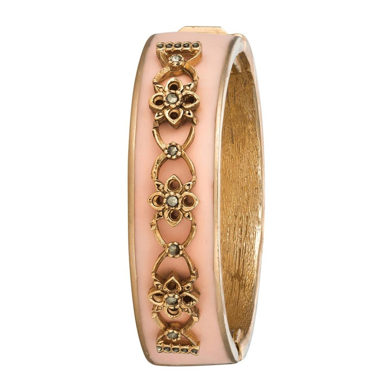 We simply adore the gorgeous pink color on this Narrow Secret Garden Bracelet. Inspire by vintage CINER compacts, this cuff adds the perfect amount of feminine charm to your jewelry repertoire.   Materials: Pewter 18K Gold Plating  Box and Tongue