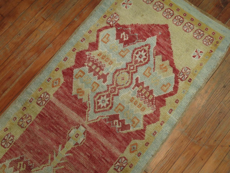 A mid-20th century Turkish Oushak runner. Pleasant color combo and contrast.