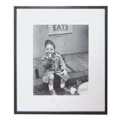 Nat Fein Silver Gelatin Photograph of a Boy Eating a Hot Dog
