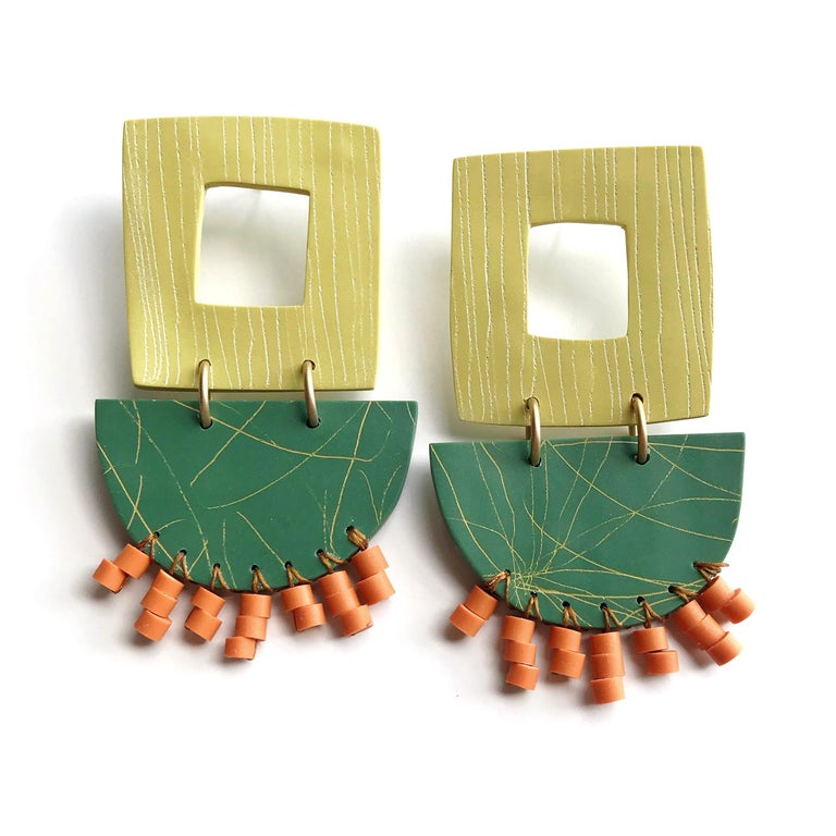 Colorful statement earrings in green, orange and yellow. Textured elements with bead woven details. Polymer clay, 18k gold-plated brass, nylon, acrylic and titanium posts.