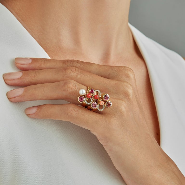 Made by hand in Nathalie Jean's Milan atelier, Microcosmos Three Rings are devised as a game, a construction or a sophisticated aerial mobile. Shapes attached to gold rings dangle lightly on the hand, their geometry pierced by diamonds (0,165