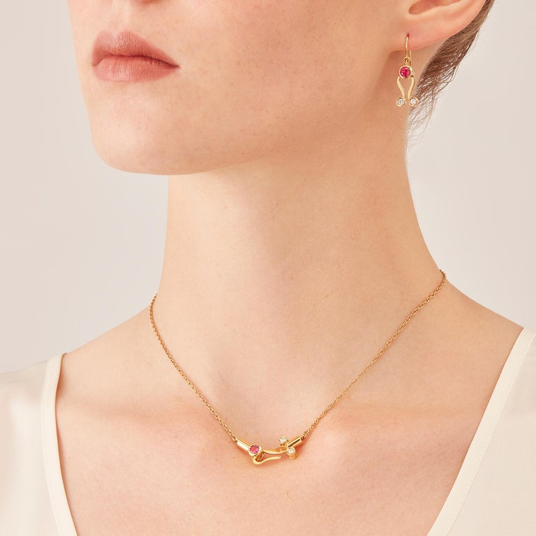 Micro Pendant and Micro Earrings in 18 karat rosé gold, a warm, sophisticated color close to yellow gold, from the Microcosmos Series, devised as a game, a construction or a sophisticated aerial mobile. Shapes attached to gold settings pivot