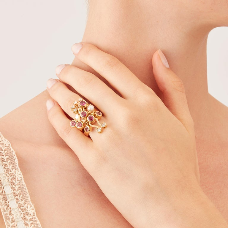 Made by hand in Nathalie Jean's Milan atelier, Microcosmos three stack rings are devised as a game, a construction or a sophisticated aerial mobile. Shapes attached to gold rings dangle lightly on the hand, their geometry pierced by diamonds (carat