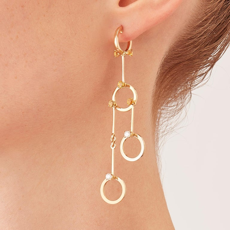 Made by hand in the Milanese atelier of Nathalie Jean, the limited edition HoiAn earrings are a graceful composition of articulated rings and bars in rosé gold, a warm, sophisticated color close to yellow gold. Miniature articulations are cleverly