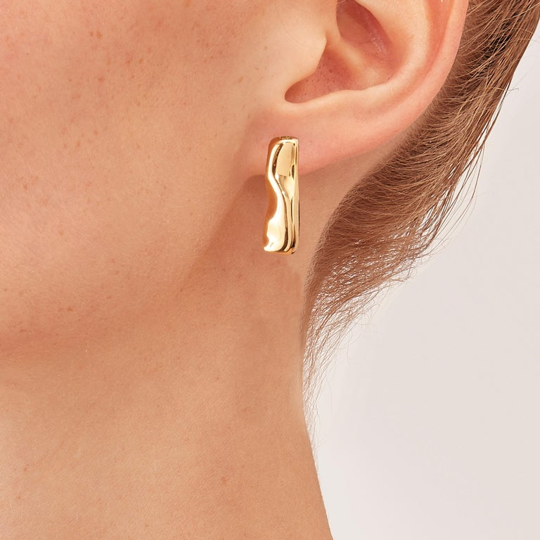 Custom made with post for Heidi, Mercure Earrings in 18 karat rosé gold, a warm, sophisticated color close to yellow gold. Small, delicate, ebbing sculptures with seemingly random forms, these supple shapes are modulated in relief and seem to flow