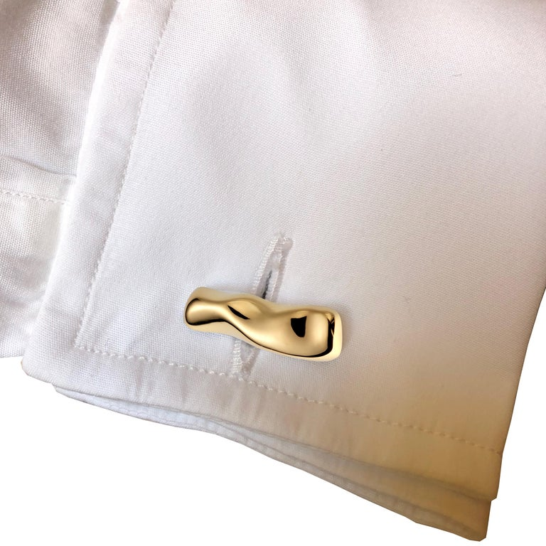 Mercure contemporary Cufflinks in yellow gold are made by hand in Nathalie Jean's Milan atelier in limited edition. Small, delicate, ebbing sculptures with seemingly random forms, these supple shapes are modulated in relief and seem to flow like