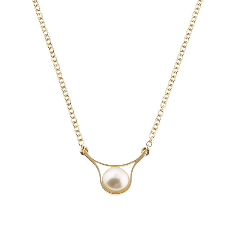 Nakkar Pendant is part of a contemporary series that pays homage to the pearl, a symbol of divinity, royalty and luxury that has fascinated and inspired since the dawn of time. A simple 18 karat gold band encircles the precious sphere to create a