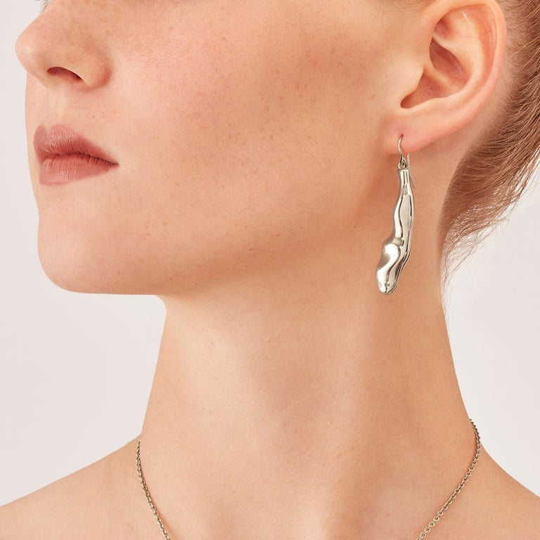 Made by hand in Nathalie Jean's Milan atelier in limited edition, Mercure Contemporary Drop Dangle Earrings are in rhodium plated sterling silver. Small, delicate, ebbing sculptures with seemingly random forms, these supple shapes are modulated in
