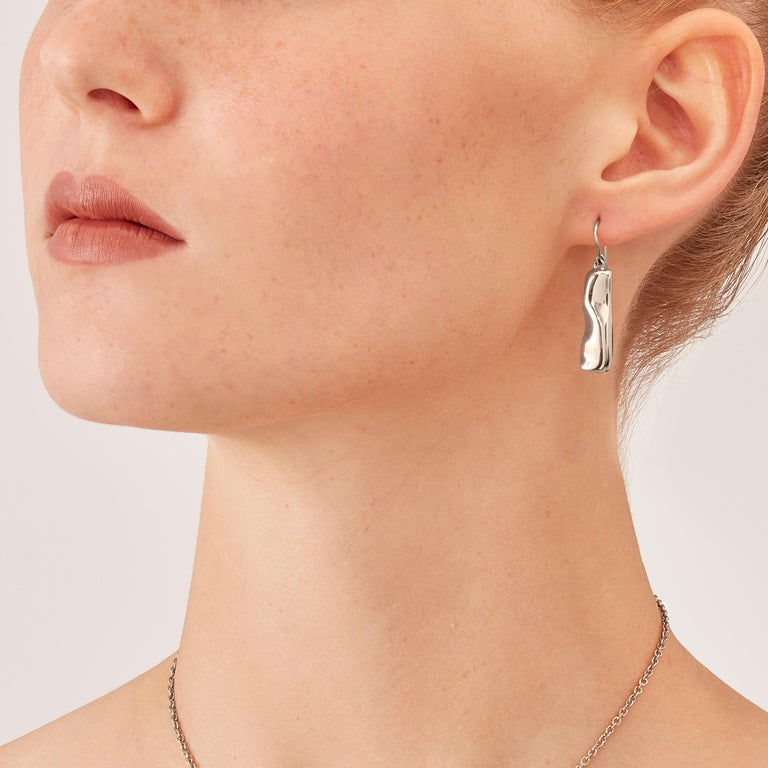 Made by hand in Nathalie Jean's Milan atelier in limited edition, the Mercure Contemporary Drop Dangle Earrings are rhodium plated sterling silver. Small, delicate, ebbing sculptures with seemingly random forms, these supple shapes are modulated in
