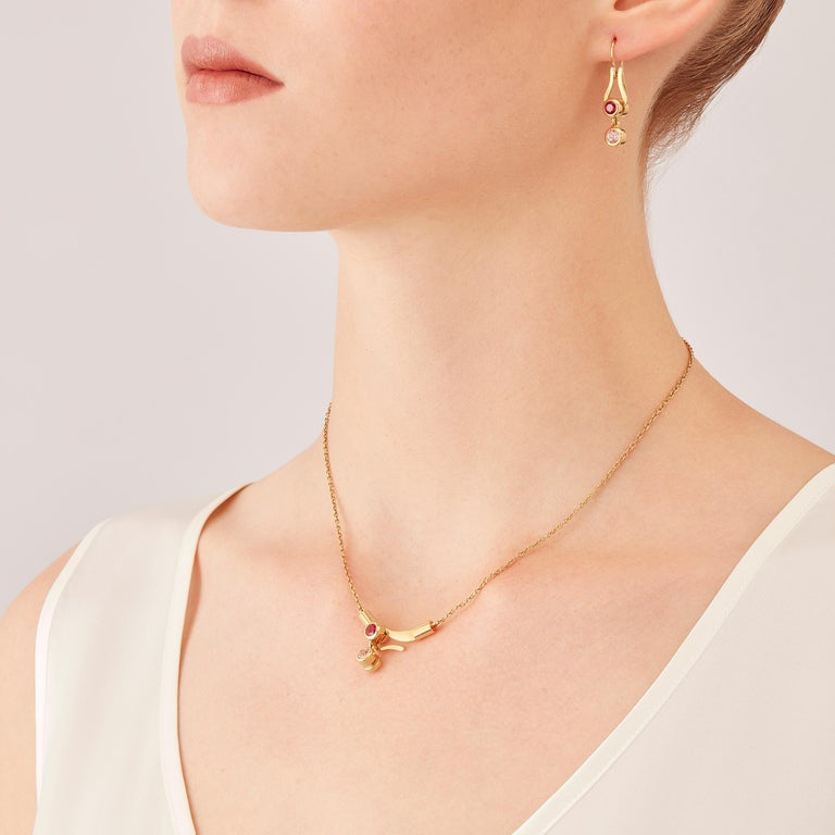 Micro pendant drop necklace in 18 karat rosé gold -a sophisticated shade of gold, between yellow and rose- from the Microcosmos Series, is devised as a game, a construction or a sophisticated aerial mobile. Shapes attached to gold settings dangle