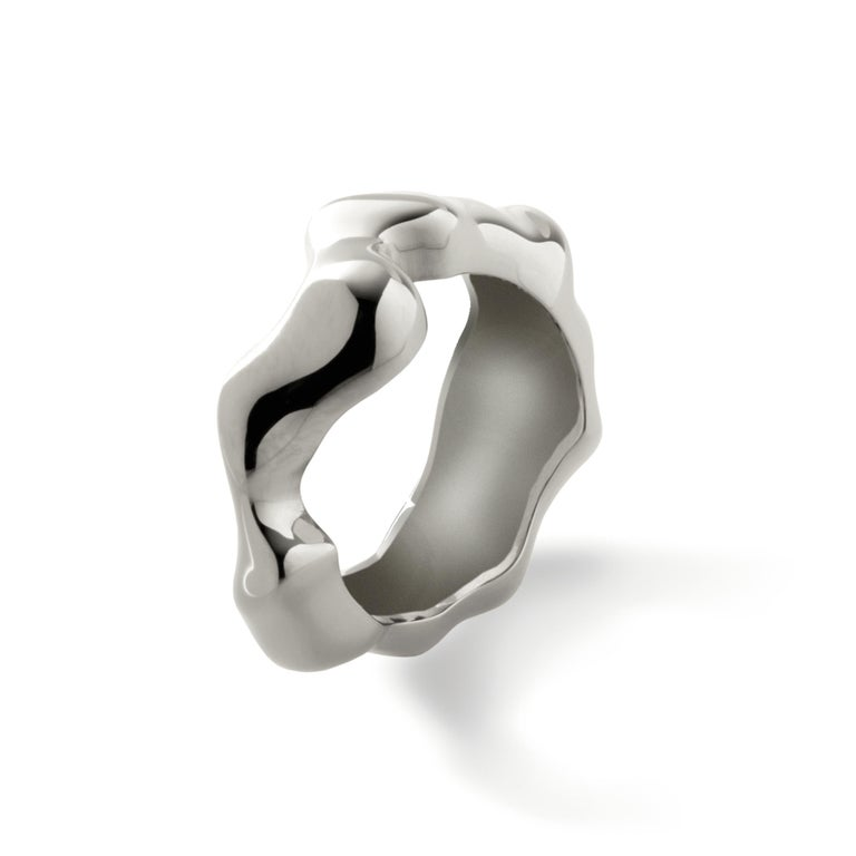 Made by hand in Nathalie Jean's Milan atelier in limited edition, Mercure Fashion Ring is in rhodium plated sterling silver. Small, delicate, ebbing sculpture with seemingly random forms, these supple shapes are modulated in relief and seem to flow