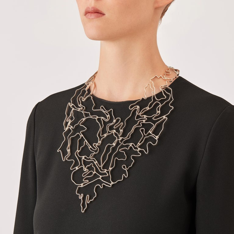 Made by hand in Nathalie Jean's Milan atelier in limited edition, the contemporary Informe Pectoral drop necklace is composed of elements of varying dimensions in polished sterling silver ribbon. It's little connecting links allow the piece to drape