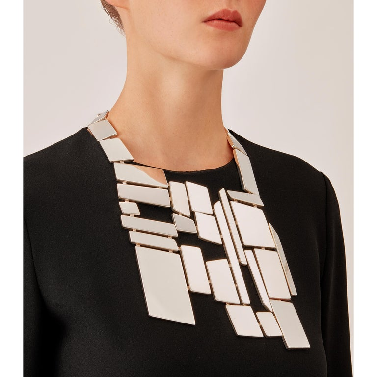 Made by hand in Nathalie Jean's Milan atelier in limited edition, Saphir Absolu Pectoral is a contemporary drop necklace composed of light hollow geometric volumes with rounded edges, in sterling silver. Clever hidden links allow the pieces to drape