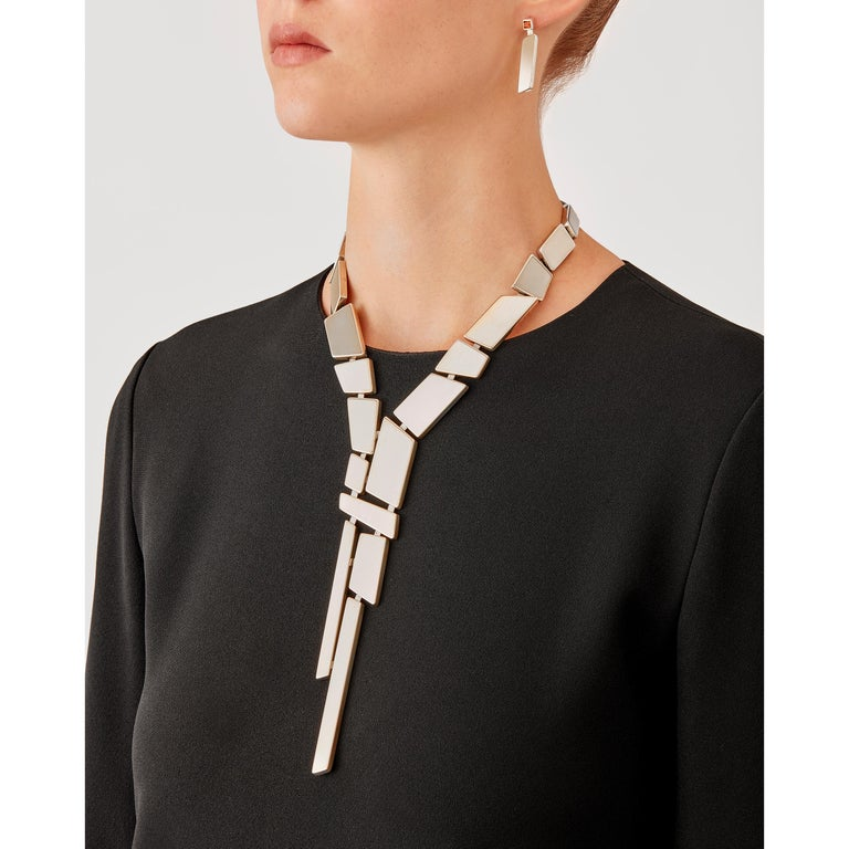 Made by hand in Nathalie Jean's Milan atelier in limited edition, the Saphir Absolu Tie Necklace is composed of light hollow geometric volumes with rounded edges, in sterling silver. Clever hidden links allow the pieces to drape around the neck and