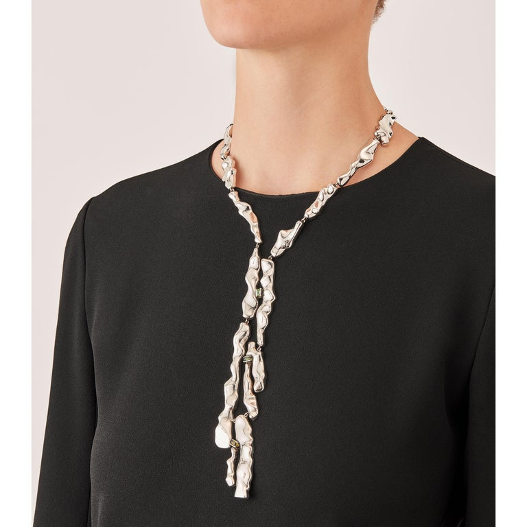 Made by hand in Nathalie Jean's Milan atelier in limited edition, the Mercure Tie drop necklace is composed of 19 elements of varying dimensions in rhodium plated sterling silver. Clever hidden links allow the pieces to drape nicely around the neck