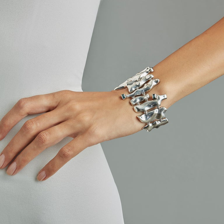 Made by hand in Nathalie Jean's Milan atelier in limited edition, Mercure cuff Bracelet is composed of 16 cleverly articulated elements of varying dimensions wrapping nicely around the wrist. Small, delicate, ebbing sculptures in rhodium plated
