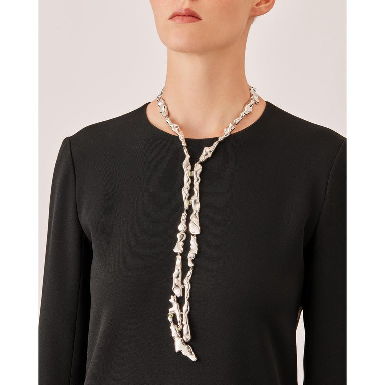 Made by hand in Nathalie Jean's Milan atelier in limited edition, Mercure Tie Necklace is composed of 19 elements of varying dimensions in rhodium plated sterling silver. Clever hidden links allow the pieces to drape nicely around the neck and drop