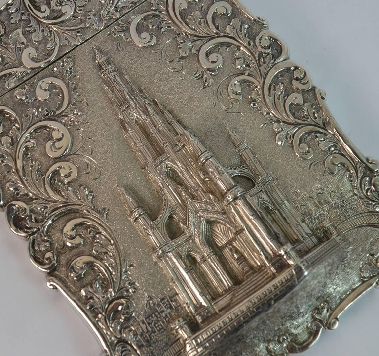 A stunning quality sterling silver card case.  Early Victorian period example by Nathaniel Mills.  The castle top design is of The Scott Memorial. The memorial was built in 1844 in memory of Scottish author Sir Walter Scott and stands in