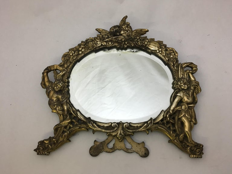 Late Victorian National Bronze and Iron Works Gilded Iron Mirror with Putti For Sale