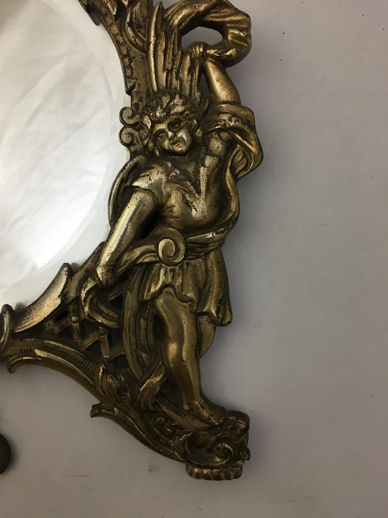 National Bronze and Iron Works Gilded Iron Mirror with Putti In Good Condition For Sale In Garnerville, NY