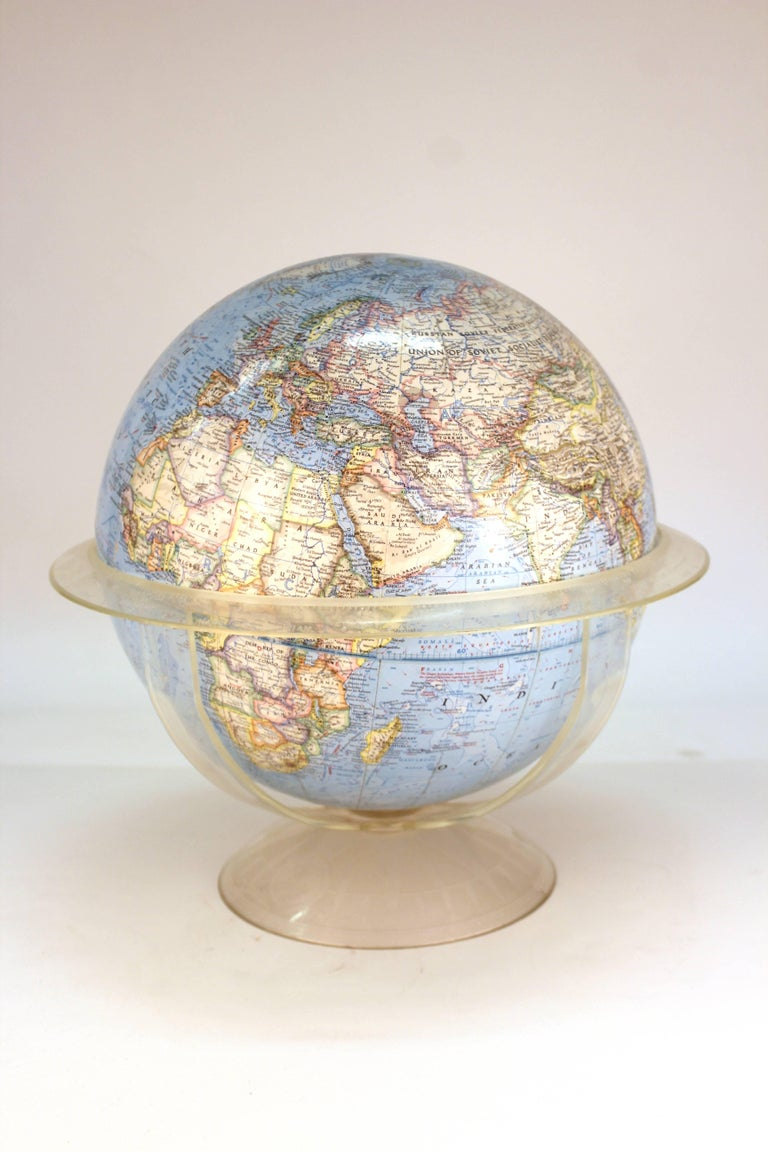 A National Geographic globe, made in 1966 in the United States. The piece is in good condition with some loss to the paper finish.