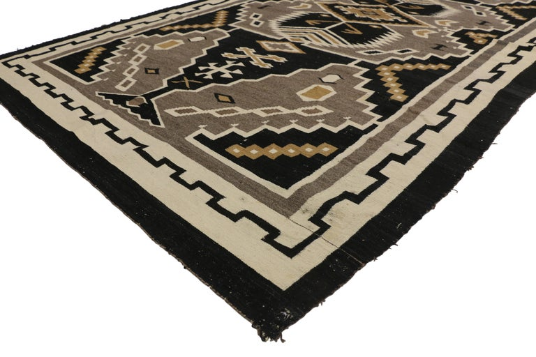 77275 Native American antique Indian Navajo Kilim rug with Adirondack Lodge style. Captivating and emanating Navajo vibes and Adirondack Lodge style, this handwoven wool antique Native American Indian Kilim area rug features an all-over geometric