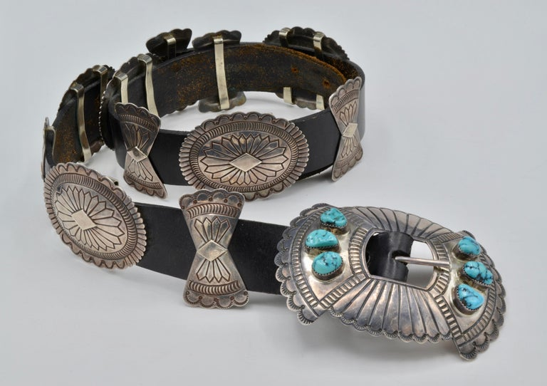 Navajo Concho Belt- This vintage leather and turquoise belt is made of silver and stamped S. James (Susie James) on the back. In fantastic condition this belt has four adjustable holes and each silver piece is hand stamped. The main buckle had six