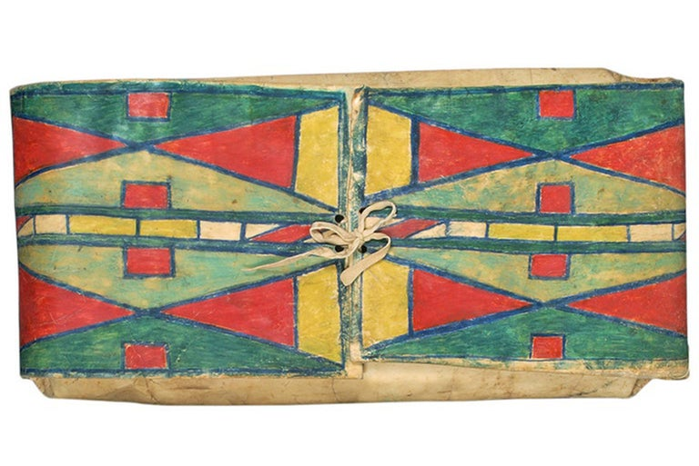 Vintage antique 19th century Native American parfleche container in an envelope form, finely painted in an abstract design by a Crow artist (Plains Indian). Makes a stunning wall hanging or can be placed on a shelf or stand.  Parfleches are rawhide