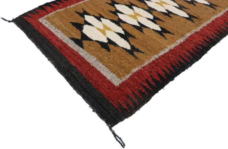 77341, native American Vintage Indian Navajo Kilim runner with Adirondack Lodge style. This handwoven wool Native American vintage Indian Navajo kilim runner features fused triangles symbolizing the wings of the butterfly which represents