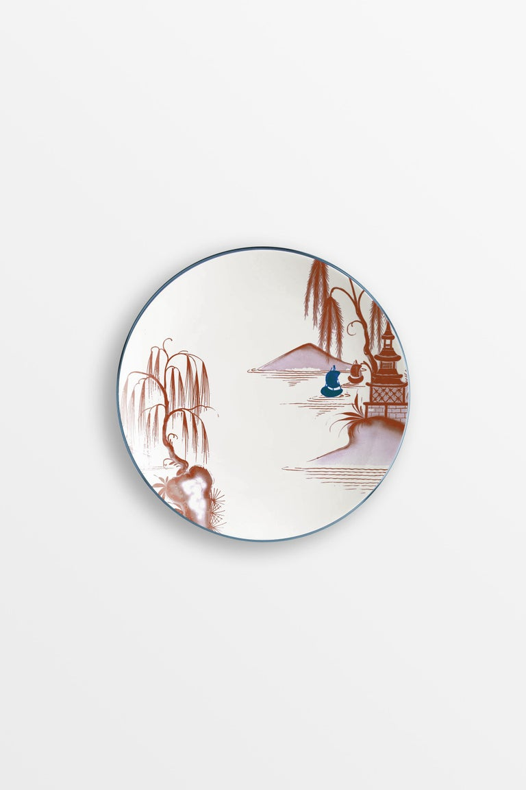 Bordeaux and blue are the primary colors of this Japan inspired collection of plates, where ancient Japanese scenes take place on the rivers of a fairy lake. 6 bread plates.
