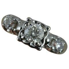 Natural 0.90 Carat Diamond and 14 Carat Gold Trilogy Ring