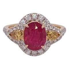 Natural 2.35 Carat Oval Ruby and Diamonds Ring