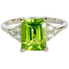 Natural 2.69 Carat Peridot VS G 6 Diamond Solid White Gold Ring
