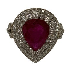 Natural 3.98 Carat Pear Shape Ruby and 1White Diamond Ring.